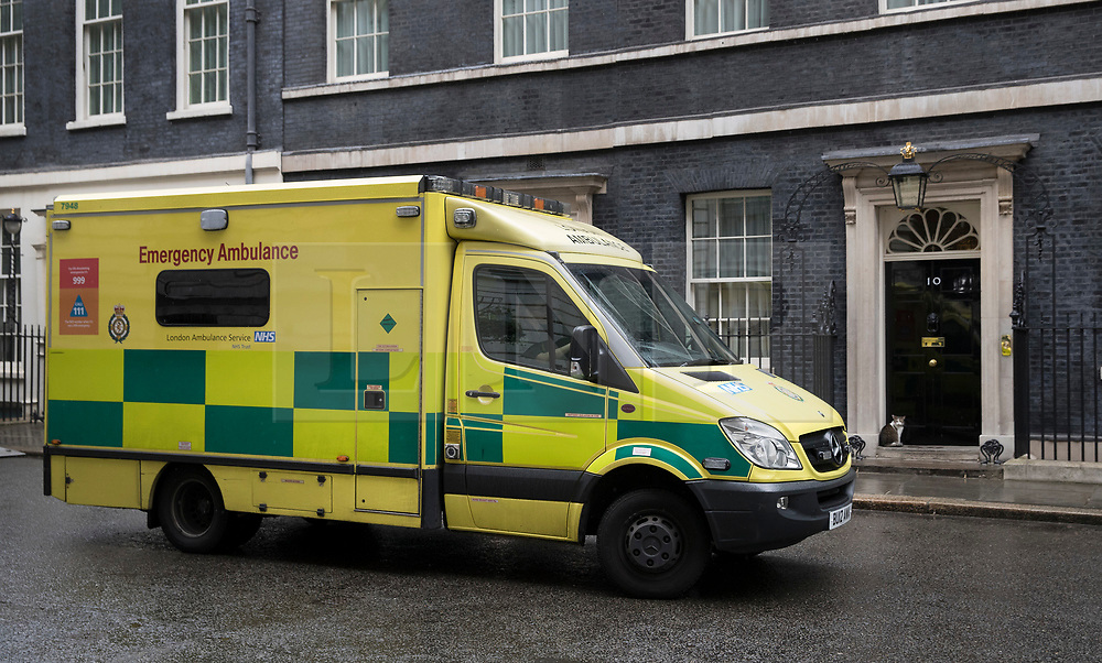 © Licensed to London News Pictures. 15/05/2017. London, UK. An ambulance passes the door of 10 Downing Street after a worker was injured inside. A COBRA meeting is being held later as members of British government are meeting to discuss the recent cyber attack on over 150 countries, which crippled parts of the NHS.  Photo credit: Peter Macdiarmid/LNP