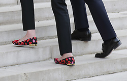 A detail view of the shoes of Prime Minister Theresa May and French President Emmanuel Macron as she arrives at the Elysee Palace during her visit to Paris, France.