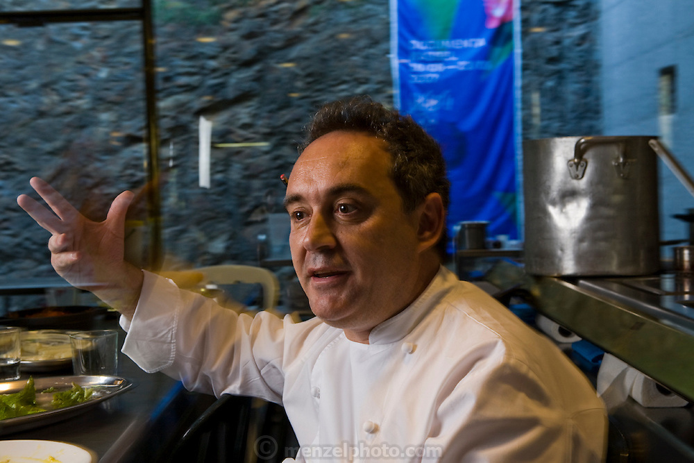Ferran Adrià, chef of El Bulli restaurant near Rosas on the Costa Brava in northern Spain, speaks to a colleague.  (Ferran Adrià is featured in the book What I Eat: Around the World in 80 Diets.)