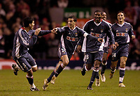 Photo: Jed Wee.<br /> Liverpool v Benfica. UEFA Champions League. 08/03/2006.<br /> <br /> Benfica celebrate with goalscorer Simao Sabrosa (20).