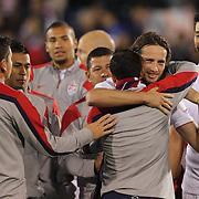 Landon Donovan, USA, ris congratulated by team mates after his farewell match during the USA Vs Ecuador International match at Rentschler Field, Hartford, Connecticut. USA. 10th October 2014. Photo Tim Clayton