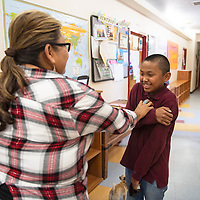 Sherril Hale asks her son Daniel Hale 11, to pose for a photo Wednesday, July 3, at DinéY.O.U.T.H. in Crownpoint. Hale's six kids participate in activities at DinéY.O.U.T.H. and says that she's grateful for the community center.