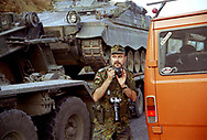 Lt. Col. Jeserich, the German Press Information Officer, shooting madly in the mountains of Albania as the German NATO convoy passes through on its way to Kosovo.