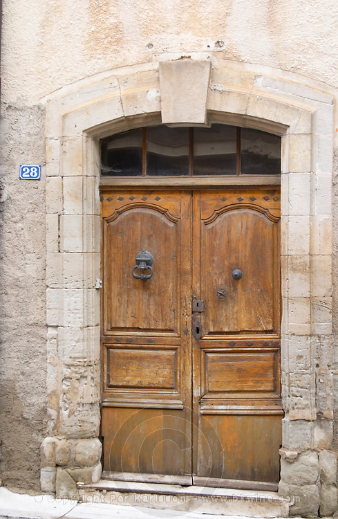 Domaine d'Aupilhac. Montpeyroux. Languedoc. A door. The winery building. France. Europe.