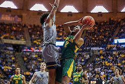 Mar 7, 2020; Morgantown, West Virginia, USA; Baylor Bears guard Jared Butler (12) shoots while defended by West Virginia Mountaineers guard Miles McBride (4) during the first half at WVU Coliseum. Mandatory Credit: Ben Queen-USA TODAY Sports