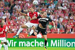 28.07.2011, Coface Arena, Mainz, GER, UEFA Europa League, Mainz 05 vs CS Gaz Metan Medias, im Bild Nikolce Noveski (Mainz #4) im Kopfballduell mit Akaki Khubutia (Gaz Metan #13) // during the GER, UEFA Europa League, Mainz 05 vs CS Gaz Metan Medias on 2011/07/28, Coface Arena, Mainz, Germany. EXPA Pictures © 2011, PhotoCredit: EXPA/ nph/  Roth       ****** out of GER / CRO  / BEL ******