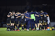 The AFC Wimbledon team does a team hug at full time after AFC Wimbledon beat Bristol Rovers 3-1 during the EFL Sky Bet League 1 match between Bristol Rovers and AFC Wimbledon at the Memorial Stadium, Bristol, England on 18 November 2017. Photo by Graham Hunt.
