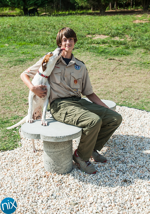Aiden Stiles, an eagle scout candidate, plays with Shana at the Humane Society of Concord & Greater Cabarrus County's Ruth's Memorial Shelter. He designed and built a bone-shaped park at the shelter.