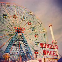 1. When was this photo taken?<br /> <br /> Guessing around 2006 or 2007<br /> <br /> 2. Where was this photo taken?<br /> <br /> Coney Island USA<br /> <br /> 3. Who took this photo?<br /> <br /> I took the photo<br /> <br /> 4. What are we looking at here?<br /> <br /> We're looking at the iconic Wonder Wheel. One of my favorite objects to shoot.<br /> <br /> 5. How does this old photo make you feel?<br /> <br /> I feel so happy every time I shoot at Coney Island, and every time I look at my images from there. It holds a dear place for me. I've always been drawn to the seaside and old piers and parks. Also, being a native New Yorker, this is always available to me and I try to go and shoot there a lot. This photo feels especially good because of the feel of the film and the imperfections.<br /> <br /> 6. Is this what you expected to see?<br /> <br /> Not sure because I didn't know what was on the roll I submitted, but to be honest - I am not surprised because I love to shoot this ride!<br /> <br /> 7. What kind of memories does this photo bring back?<br /> <br /> The smells and sounds of the park and the boardwalk....<br /> <br /> 8. How do you think others will respond to this photo? <br /> <br /> I imagine people will remember their own experience there, when they look at this? Or if they have never been, perhaps imagine what it is like...