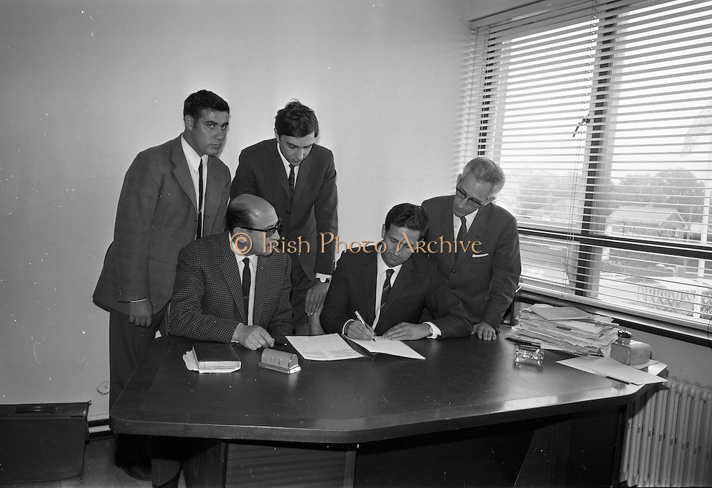 14/07/1967<br /> 07/14/1967<br /> 14 July 1967<br /> Spanish visitors signing a business agreement at Unidare Engineering Ltd. Portadown Co. Armagh.