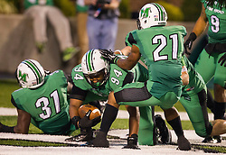Oct 9, 2015; Huntington, WV, USA; Marshall Thundering Herd defensive lineman Jarquez Samuel (94) dives into the end zone for a touchdown after an interception during the third quarter against the Southern Miss Golden Eagles at Joan C. Edwards Stadium. Mandatory Credit: Ben Queen-USA TODAY Sports