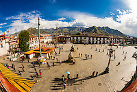 """Overview of Barkhor Square with the Jokhang Temple on the left. Tibetan pilgrims circumambulate the route called """"The Barkhor"""" around the temple, which is the most sacred in Tibet. Lhasa, Tibet, China."""