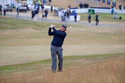 Phil Mickelson plays his approach shot from the rough to the 1st green during day one of the Aberdeen Asset Management Scottish Open at Gullane Golf Club, East Lothian.