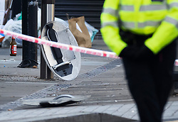 © Licensed to London News Pictures. 23/11/2020. London, UK. Police riot shields can be scene in a cordoned off area in Westgate Street, Hackney in east London where a woman, believed to be aged in her 30s, was found suffering from a gunshot injury. CPR was administered at the scene by police officers before the arrival of ambulance medics. She was then transported to an east London hospital; her condition is being treated as life-threatening. Photo credit: Peter Macdiarmid/LNP