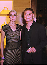 Leading British Formula One racing driver DAVID COULTHARD and MISS HEIDI WICHLINSKI, at a party in London on 24th February 1998.MFP 73