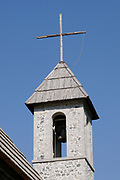 The shingled bell tower of the nineteenth century Roman Catholic church in Teth. The church has the stone walls and shingled roof typical of the region. Teth, Tethi, Albania. 03Sep15