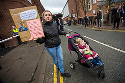© Licensed to London News Pictures. 06/11/2019. Workington UK. A Young woman & her child protest against Brexit outside the Washington Central Hotel where Brexit Party Leader Nigel Farage is today as he continues his nationwide tour as part of the General Election Campaign. Photo credit: Andrew McCaren/LNP