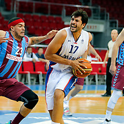 Anadolu Efes's Cenk Akyol (C) and Trabzonspor's Sean James Marshall (L) during their friendly match Anadolu Efes between Trabzonspor at Abdi Ipekci Arena in Istanbul Turkey on Saturday 16 May 2015. Photo by Aykut AKICI/TURKPIX