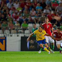 Sweden's Zlatan Ibrahimovic (L) fights for the ball with Hungary's Zsolt Korcsmar (C) and Adam Pinter (R dudring the UEFA EURO 2012 Group E qualifier Hungary playing against Sweden in Budapest, Hungary on September 02, 2011. ATTILA VOLGYI