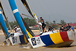Adam Minoprio (NZL) and Peter Gilmour (AUS) rounding the top mark. Monsoon Cup 2009. Kuala Terengganu, Malaysia. 4 December 2009. Photo: Sander van der Borch / Subzero Images