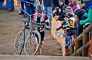 SHOT 1/12/14 4:35:06 PM - Jeremy Powers (#3) of Easthampton, Ma. runs with his bike in the 5280' Run Up section as he competes in the Men's Elite race at the 2014 USA Cycling Cyclo-Cross National Championships at Valmont Bike Park in Boulder, Co. Powers won the event with a time of 59:16.  (Photo by Marc Piscotty / © 2014)