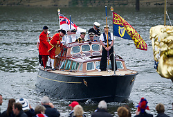 © Licensed to London News Pictures. 03/06/2012. London, UK. HRH The Queen arriving by boat at Cadogan Pier to board The Royal Barge Spirit of Chartwell during the Jubilee Pageant on the River Thames, London on June 03,2012 as part of The Diamond Jubilee celebrations. Great Britain is celebrating the 60th  anniversary of the countries Monarch HRH Queen Elizabeth II accession to the throne . Photo credit : Ben Cawthra/LNP