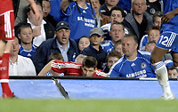 Photo: Richard Lane.<br />Chelsea v Liverpool. UEFA Champions League. Semi Final, 1st Leg. 25/04/2007. <br />Liverpool's Steven Gerrard climbes out after falling into the crowd.