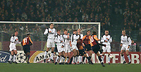 Fotball, Liverpool defenders watch as Roma Francesco Totti fires in a free-kick.