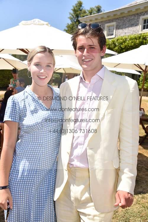 Lady Eloise Gordon-Lennox and George Hill at the 'Cartier Style et Luxe' enclosure during the Goodwood Festival of Speed, Goodwood House, West Sussex, England. 15 July 2018.