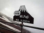 The sign at the top of Mount Fuji, or Fujiyama, in Japan indicating the height.  3,250 meters = 10,662.73 feet<br /> It is the tallest mountain in Japan.<br /> Location: Yamanashi, Honshu, Japan