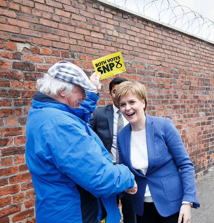 FIRST MINISTER STURGEON TO MEET WORKFORCE AT GOVAN SHIPYARD. Nicola Sturgeon (C) walking along Govan Rd, Glasgow to meet workers at the BAE Shipyard in Govan.  Meeting a local activist with candidates Humza Yousaf (R).  Picture Robert Perry 25th April 2016<br /> <br /> Must credit photo to Robert Perry<br /> FEE PAYABLE FOR REPRO USE<br /> FEE PAYABLE FOR ALL INTERNET USE<br /> www.robertperry.co.uk<br /> NB -This image is not to be distributed without the prior consent of the copyright holder.<br /> in using this image you agree to abide by terms and conditions as stated in this caption.<br /> All monies payable to Robert Perry<br /> <br /> (PLEASE DO NOT REMOVE THIS CAPTION)<br /> This image is intended for Editorial use (e.g. news). Any commercial or promotional use requires additional clearance. <br /> Copyright 2014 All rights protected.<br /> first use only<br /> contact details<br /> Robert Perry     <br /> 07702 631 477<br /> robertperryphotos@gmail.com<br /> no internet usage without prior consent.         <br /> Robert Perry reserves the right to pursue unauthorised use of this image . If you violate my intellectual property you may be liable for  damages, loss of income, and profits you derive from the use of this image.