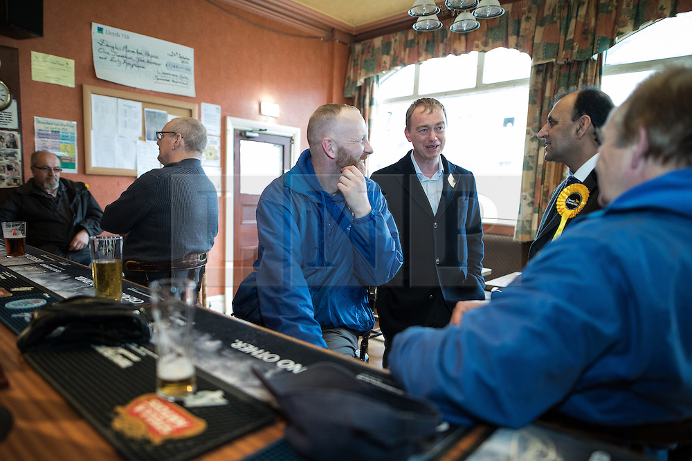 © Licensed to London News Pictures . 14/02/2017 . Stoke-on-Trent , UK . Lib Dem leader TIM FARRON with candidate DR ZULFIQAR ALI at the Liberal Democrat by-election base in the Wheatsheaf Pub on Sheaf Street , campaigning in the Stoke Central by-election . Photo credit : Joel Goodman/LNP