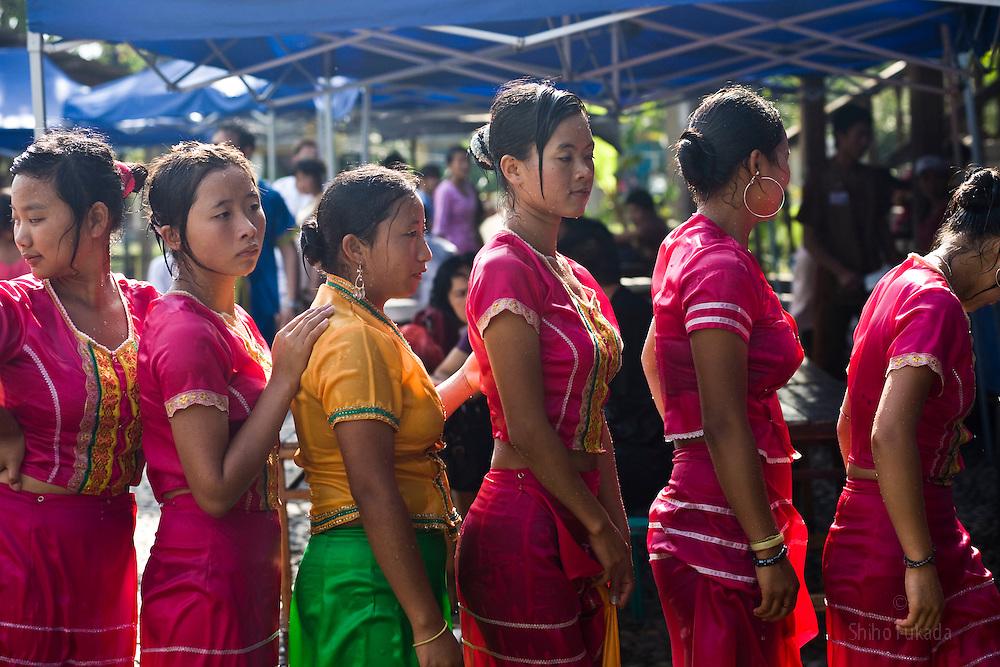 Dai women working for the Dai Minority Park after water splashing in Yunnan, China.