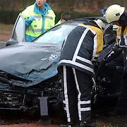 Ongeval met beknelling Crailoseweg Huizen, brandweer, ambulance, chaos