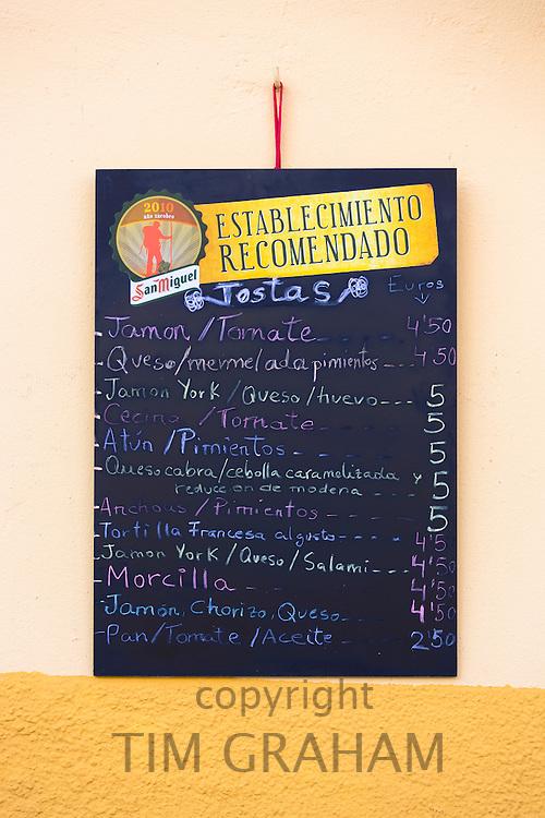 Traditional menu tariff for tapas raciones at bar restaurant Montanes in Plaza de Santo Martino in Leon, Castilla y Leon, Spain