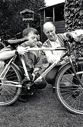 Young man with Down's Syndrome with his father UK 1995 MR
