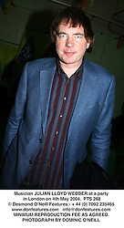 Musician JULIAN LLOYD WEBBER at a party in London on 4th May 2004.PTS 268