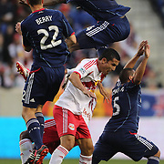 Bakary Soumare, Chicago Fire, leaps over Tim Cahill, New York Red Bulls, during the New York Red Bulls V Chicago Fire, Major League Soccer regular season match at Red Bull Arena, Harrison, New Jersey. USA. 27th October 2013. Photo Tim Clayton