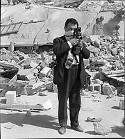 Terry Fincher, British press photographer seen photographing the Agadir earthquake in Morocco in 1960.