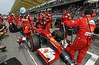 MOTORSPORT - F1 2014 - GRAND PRIX OF MALAYSIA  - SEPANG (MAL) - 28 TO 30/03/2014 - <br /> ALONSO FERNANDO (SPA) - FERRARI F14T - AMBIANCE PORTRAIT<br /> GRILLE DE DEPART - STARTING GRID