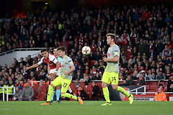 Arsenal's Alexis Sanchez (left) scores his side's second goal of the game