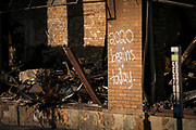 Graffiti adorns one of the few remaining walls of the Town Talk Diner building along Lake Street in Minneapolis, Minnesota on Monday, June 1, 2020. The restaurant and commercial building was razed to the ground during the civil unrest that overwhelmed the Twin Cities in the final days of May following the death of George Floyd at the hands of Minneapolis Police Department officers.