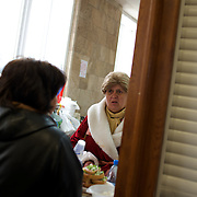 A pro-Russia activist serves food at one of the kitchens set up inside Donbass Regional Government building in central Donetsk. Barricades around the building, occupied since the past weekend, have been fortified throughout the day, as the ultimatum given by the government in Kiev for the activists to abandon the building within 48 hours, is approaching its deadline.