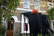 A Halloween pumpkin is positioned on top of a black shroud outside a house on 31 October 2020 in Windsor, United Kingdom. Halloween celebrations, and in particular the custom of trick-or-treating, will vary across the UK this year due to coronavirus restrictions which differ by Tier alert levels and the Prime Minister's official spokesman has urged people to apply common sense.