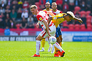 Paul Downing of Doncaster Rovers (31) and Lyle Taylor of Charlton Athletic (9) in action during the EFL Sky Bet League 1 play off first leg match between Doncaster Rovers and Charlton Athletic at the Keepmoat Stadium, Doncaster, England on 12 May 2019.