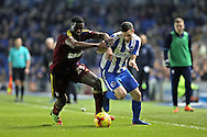 Brighton & Hove Albion winger Jamie Murphy (15) takes on Ipswich Town defender Josh Emmanuel (29) during the EFL Sky Bet Championship match between Brighton and Hove Albion and Ipswich Town at the American Express Community Stadium, Brighton and Hove, England on 14 February 2017.