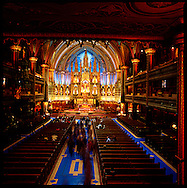 La basilique Notre-Dame de Montreal ocated in Vieux Montreal, the historic district of the city, has one of the  most dramatic sanctuaries in the world.