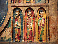 Thirteenth century Romanesque carved and painted altar depicting the Apostles from St. Maria de Taull, Vall de Boi, High Ribagorca, Spain.  National Art Museum of Catalonia, Barcelona. Ref: MNAC 3904 ..<br /> <br /> If you prefer you can also buy from our ALAMY PHOTO LIBRARY  Collection visit : https://www.alamy.com/portfolio/paul-williams-funkystock/romanesque-art-antiquities.html<br /> Type -     MNAC     - into the LOWER SEARCH WITHIN GALLERY box. Refine search by adding background colour, place, subject etc<br /> <br /> Visit our ROMANESQUE ART PHOTO COLLECTION for more   photos  to download or buy as prints https://funkystock.photoshelter.com/gallery-collection/Medieval-Romanesque-Art-Antiquities-Historic-Sites-Pictures-Images-of/C0000uYGQT94tY_Y