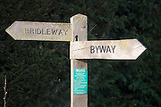 Wooden signpost for bridleway and byway with direction pointers, Suffolk, England