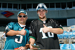 Philadelphia Eagles fans pose for a picture before the NFL game between the Philadelphia Eagles and the Carolina Panthers on September 13th 2009. The Eagles won 38-10 at Bank of America Stadium in Charlotte, North Carolina.  (Photo By Brian Garfinkel)